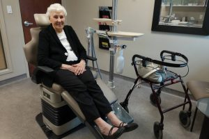 Lady sitting comfortably in dentist chair