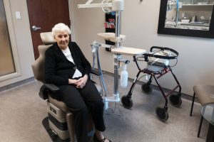 Lady at the denturist in a dentist chair