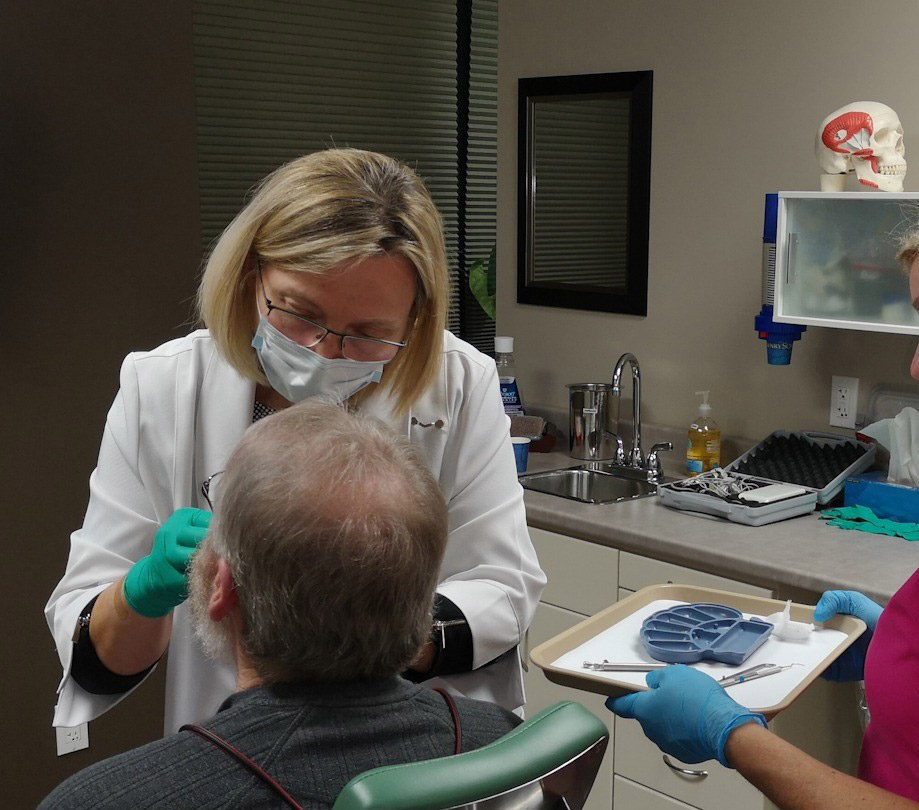 Nancy Tomkins working on dental implants